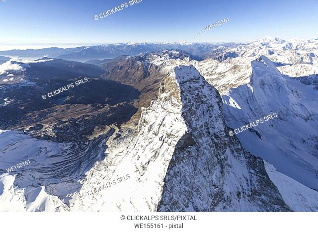 Aerial view of the snowy peak of Matterhorn with the alpine village of Cervinia in the background Zermatt canton of Valais Switzerland Europe