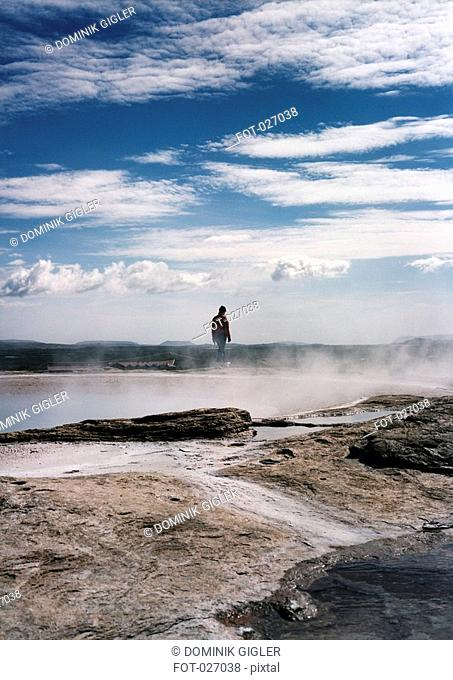 Person standing on a volcanic landscape