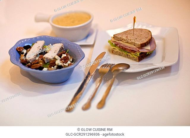 High angle view of salad with sandwich and soup