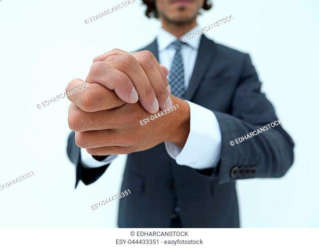 Businessman rubbing his hands together
