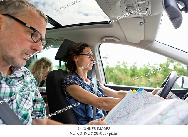 Family travelling in car