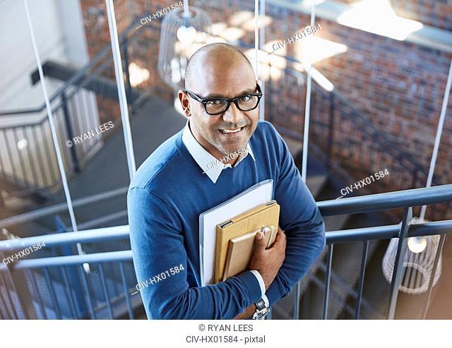 Portrait confident businessman in stairway