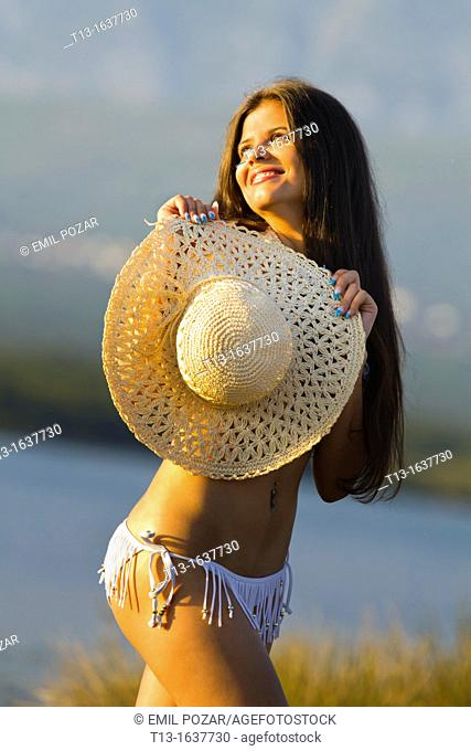 Happy in the sunset young woman