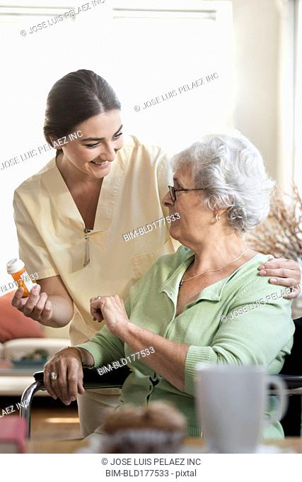 Caucasian nurse explaining medication to patient