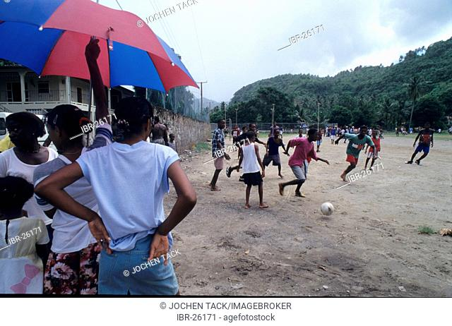 LCA, Saint Lucia: playing soccer, Canaries