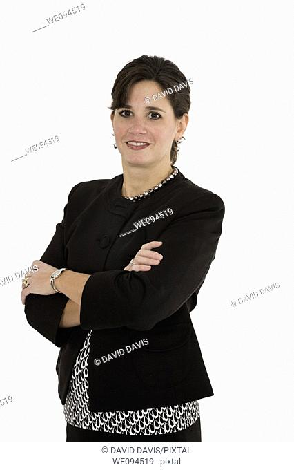Caucasian businesswoman smiling while standing on a white background
