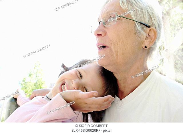 Woman with granddaughter outdoors