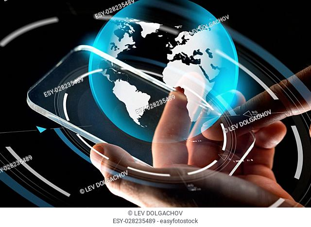 business, mass media, people and future technology concept - close up of hands with transparent smartphone and virtual earth hologram over black background