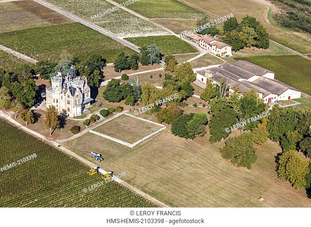 France, Gironde, Cussac Fort Medoc, grape harvesters in the Haut Medoc vineyards before Chateau Lachesnay (aerial view)