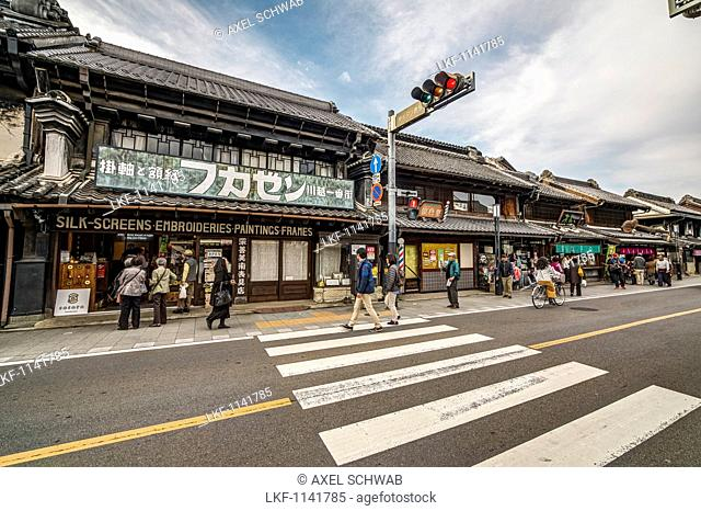 Shops and tourists along Kurazukuri Street called Little Edo in Kawagoe, Saitama Prefecture, Japan'