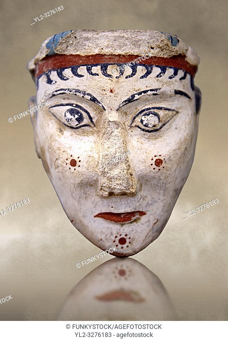 A unique plaster head of a women, possibly a goddess of sphinx, one of the few examples of Mycenaean plater art. The severe expression is excentualted by red...