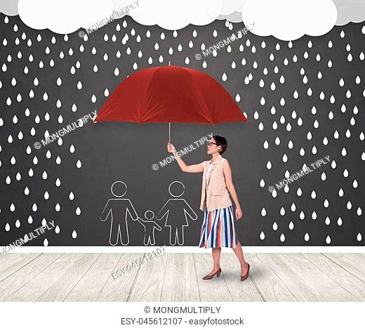 Businesswomen holding red umbrella protecting family.insurance policy Life health protection conceptaul