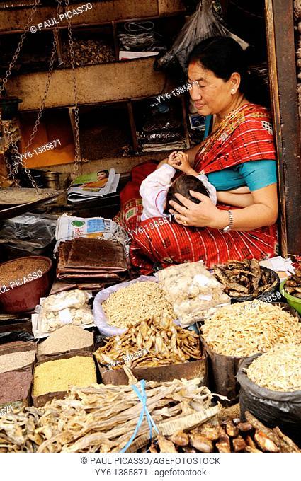 old nepalese lady selling herbs and spices , the nepalis , life in kathmandu , kathmandu street life , nepal