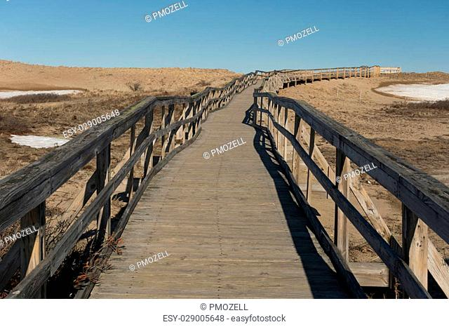 Newbury,MA USA - April 04, 2015. A boardwalk crosses the protected sand dunes of the Parker River National Wildlife Refuge
