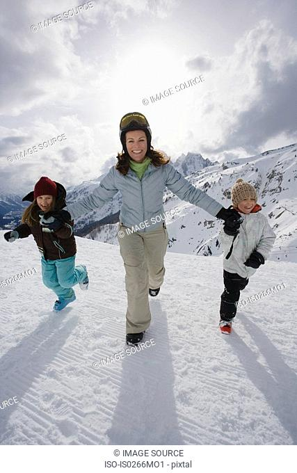 Mother and children in the snow