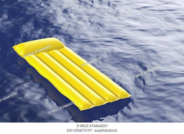 Yellow inflatable pool mattress floating on wavy water