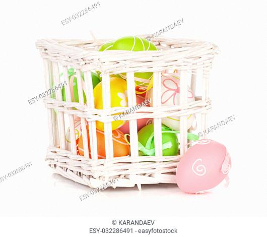 Colorful easter eggs basket. Isolated on white background