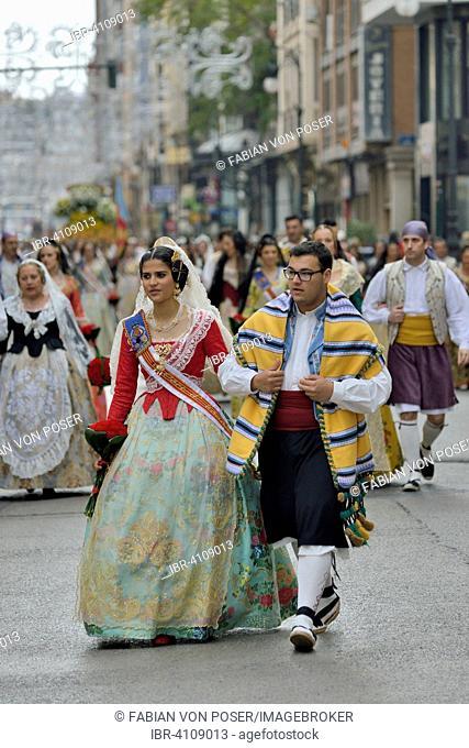 Fallas festival, parade, flower offering, at Plaza de la Virgen de los Desamparados, Valencia, Spain