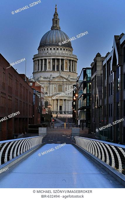 Morning dawns at St. Paul's as seen from Millennium Bridge, City of London, UK