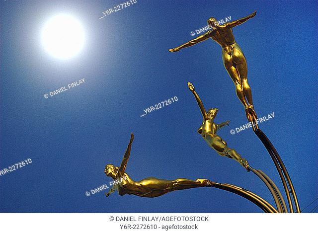 Golden Girls sculpture and the moon above the Piccadilly Circus area in the heart of London, UK