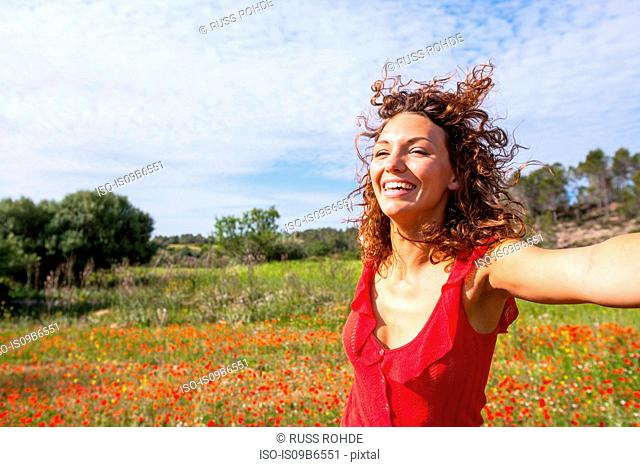 Woman dancing in poppy field, Palma de Mallorca, Islas Baleares, Spain, Europe