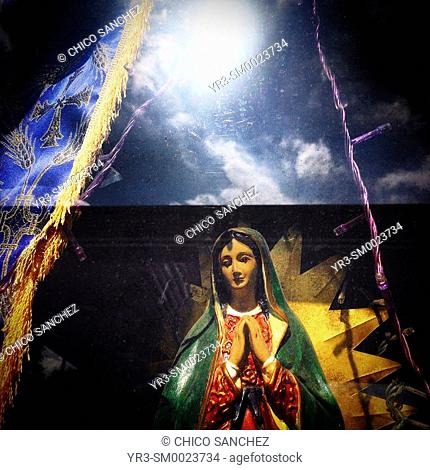 The sun shines reflected in an altar to Our Lady of Guadalupe in Mexico City, Mexico
