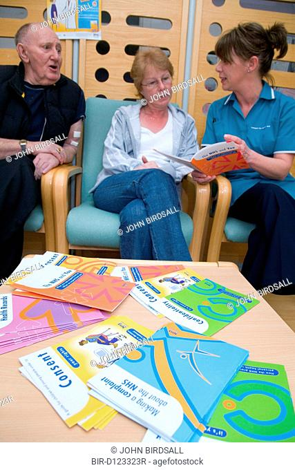 Nurse going through NHS leaflets with patients on the Nottingham City Hospital Renal Unit