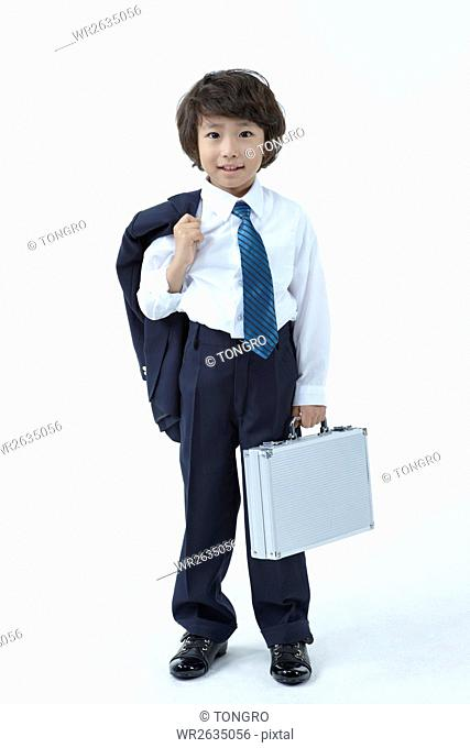 Smiling boy dressed like a businessman