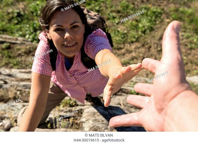Female Rock Climber Reaching for Helping Hand in Ticino, Switzerland