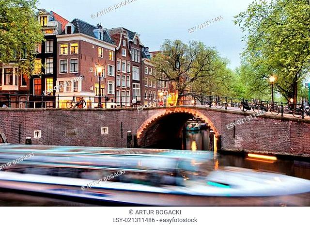 Canal Bridge and Boat Tour in Amsterdam at Evening