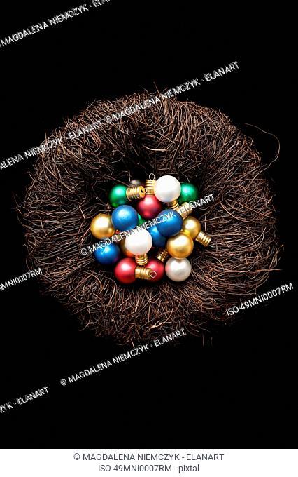Christmas ornaments in birds nest
