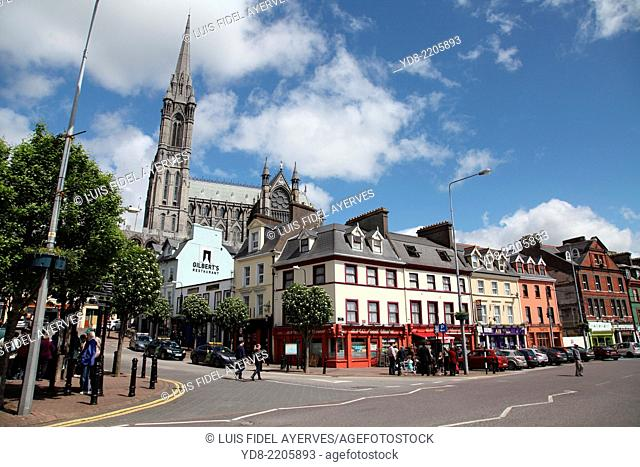 Typical street in the town of Cobh with its cathedral background, Ireland, Europe