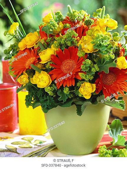 Arrangement of gerberas, globe flowers, lady's mantle & grasses
