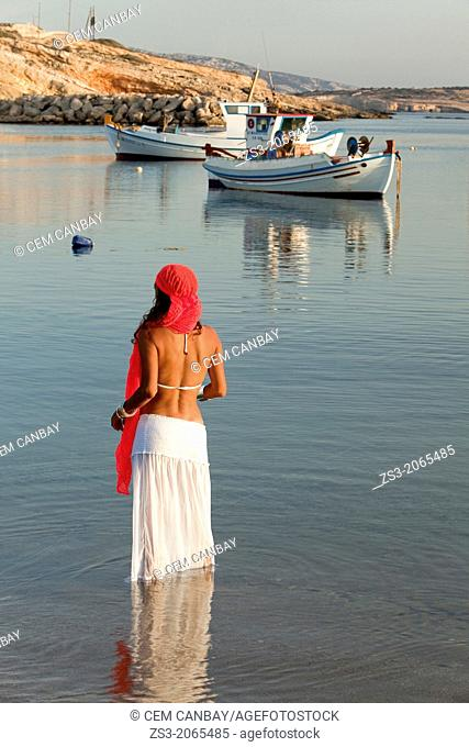 Woman with a scarf in the sea, Koufonissi, Cyclades Islands, Greek Islands, Greece, Europe