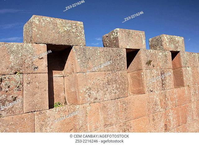 Stone walls of ancient buildings at the Pisac Ruins of the Inca empire, Pisac, Cusco Region, Peru, South America