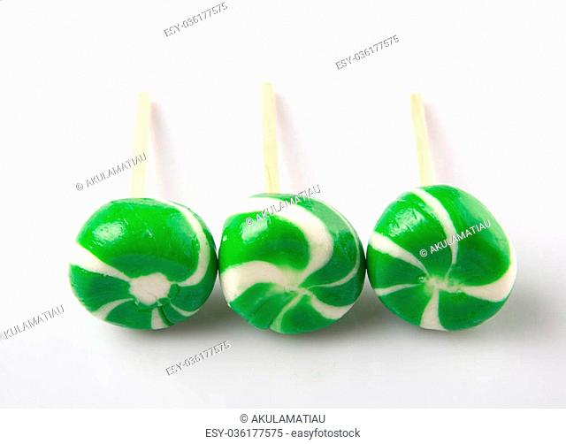Green swirl peppermint candies over white background