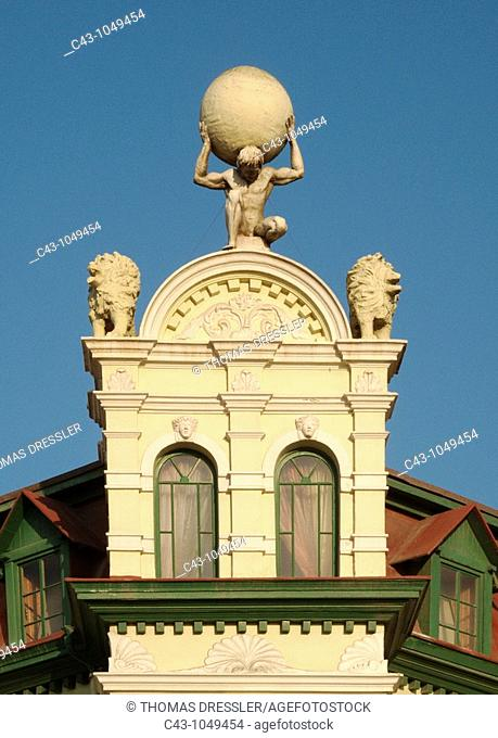 Namibia - The fibreglass cast of Atlas supporting the world crowns the baroque-style Hohenzollern Building constructed in 1906 in the seaside town of Swakopmund