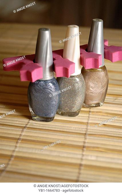 Woman's manicure and pedicure supplies including nail lacquer, and Toenail separator