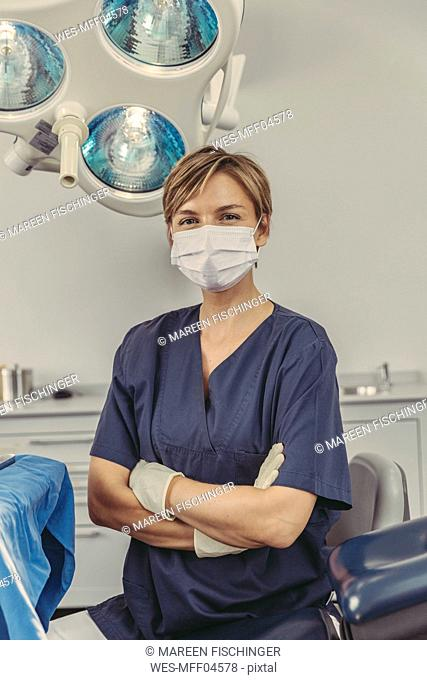 Dental surgeon wearing surgical mask, portrait