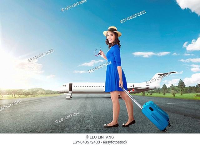 Attractive asian woman going vacation with airplane over blue sky background