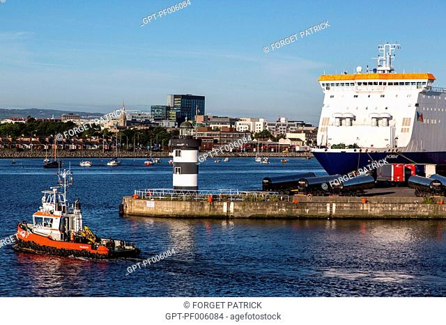 TUGBOAT LEAVING THE COMMERCIAL PORT OF DUBLIN, IRELAND