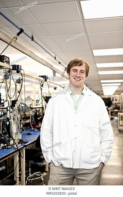 A portrait of a Caucasian male technician in a technical research and development site