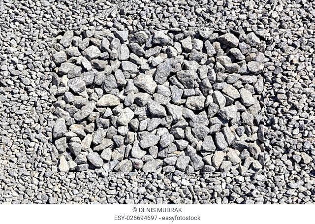 Texture of granite gravel. High resolution image of granite gravel in construction industry