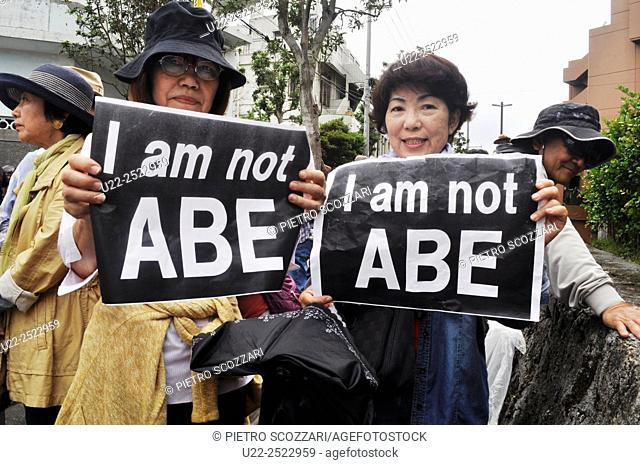 Naha, Okinawa, Japan: women protesting against Prime Minister Abe