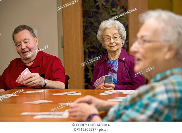 Senior citizens enjoying life in their shared residence; Edmonton, Alberta, Canada