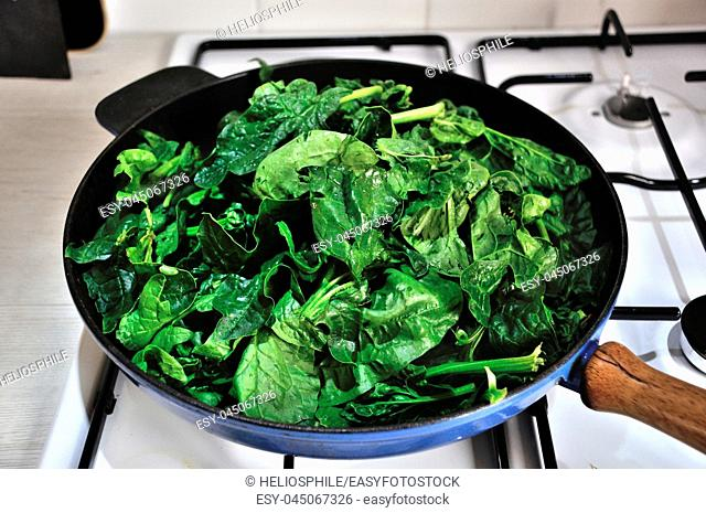 Fresh spinachs on a pan