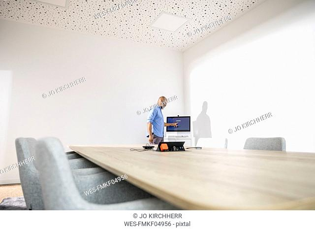 Businessman in conference room preparing a presentation