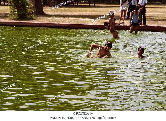 Children bathing in a pond, India Gate, New Delhi, India