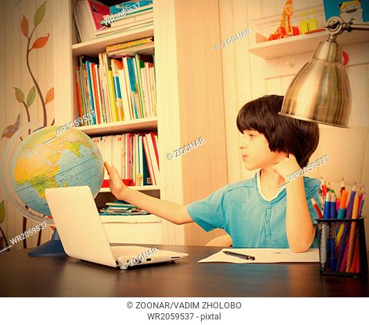 studying geography, boy and globe