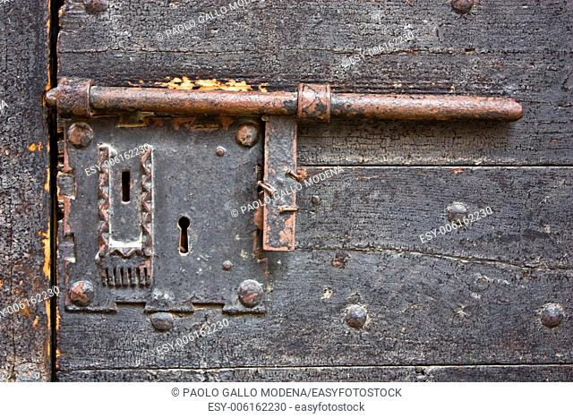 Ancient lock made of metal on a medieval door